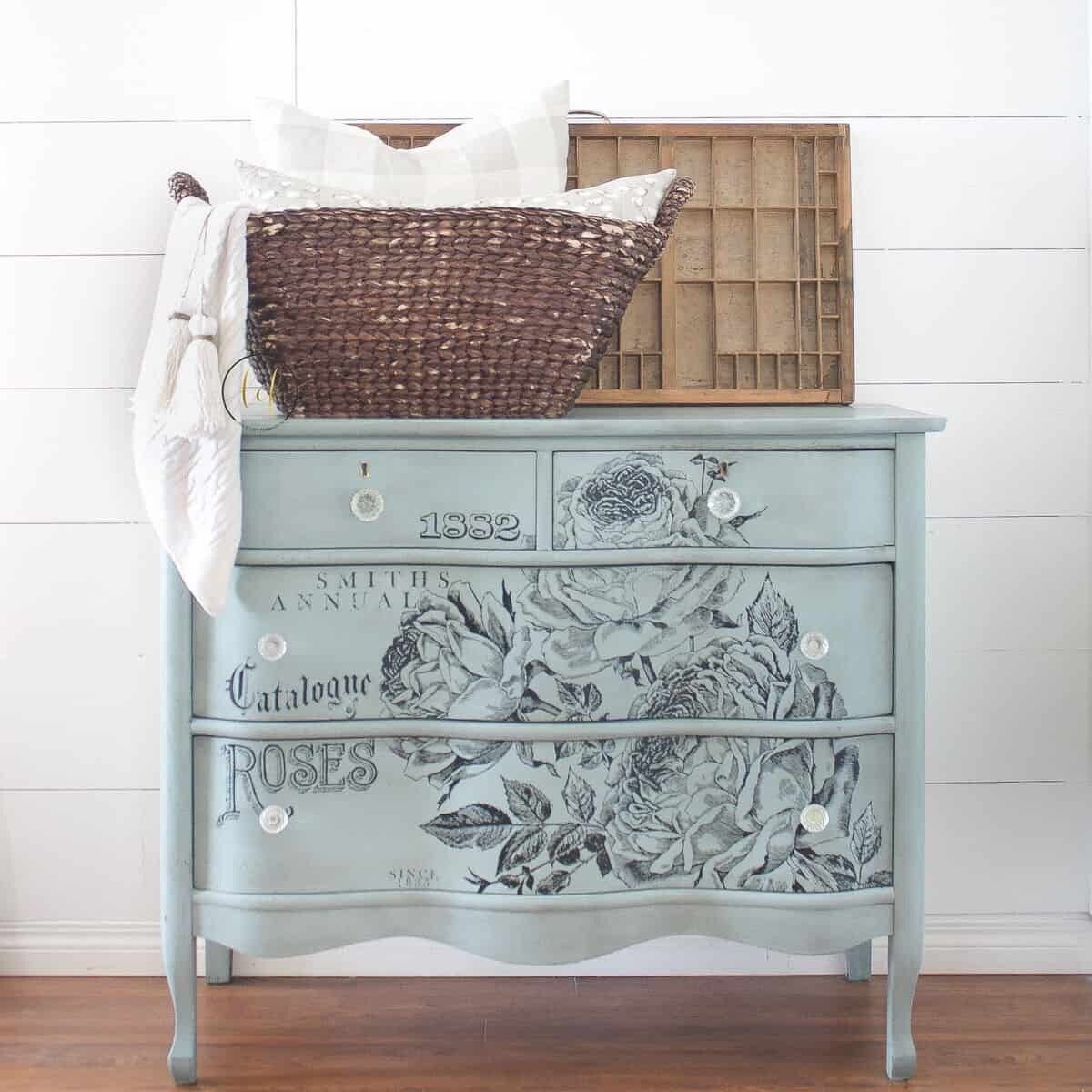 A wooden end table painted in the Country Chic Paint dusty blue color Elegance.