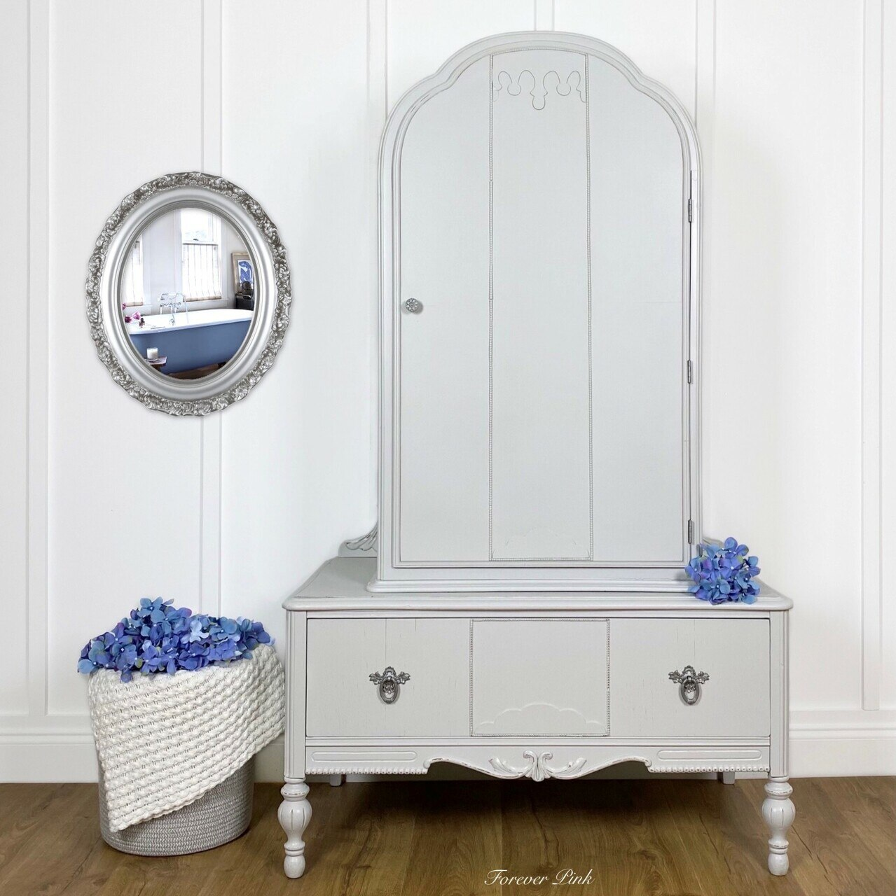 A wooden cabinet painted in the Country Chic Paint pale grey color Lazy Linen.