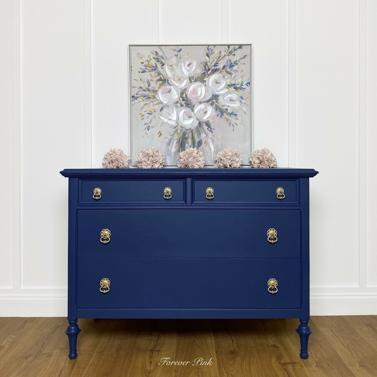 A wooden dresser painted in the Country Chic Paint dark blue color Starstruck.