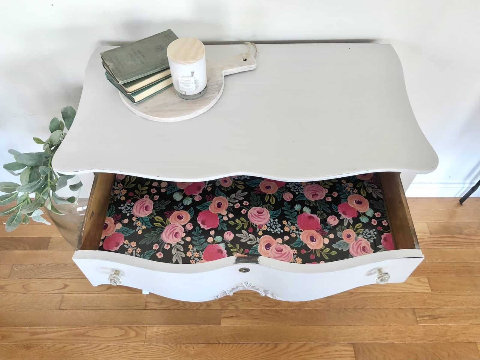 light grey painted desk with pink floral drawer liner