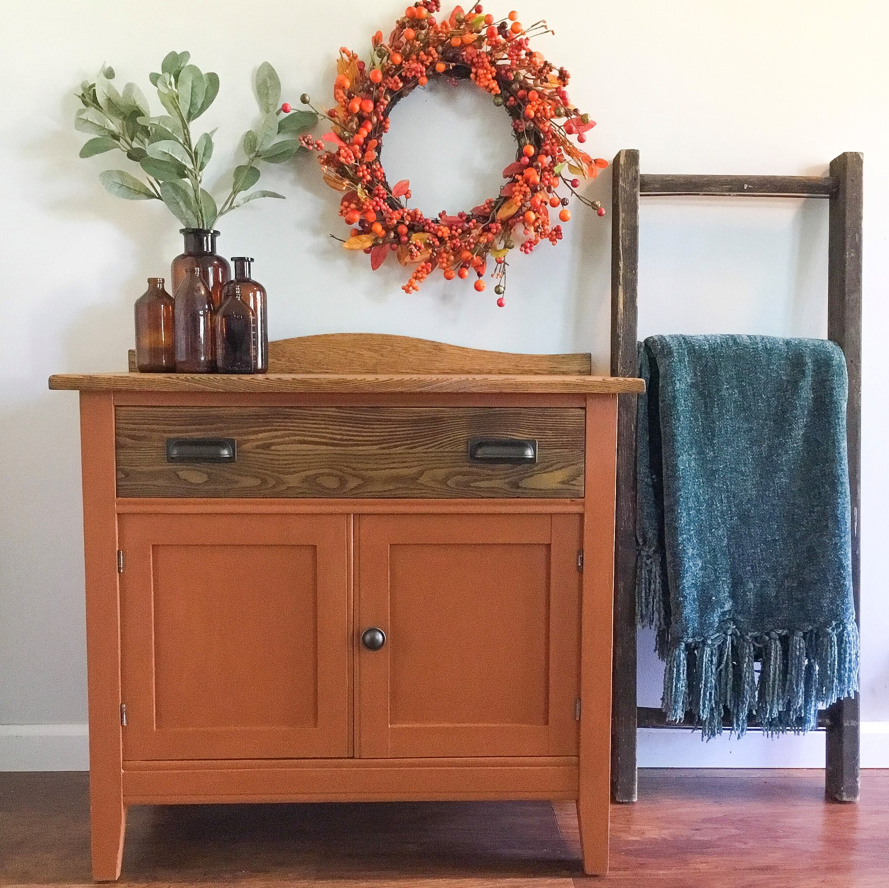Farmhouse Cabinet in With A Twist with Stained Wood Drawer and Wreath