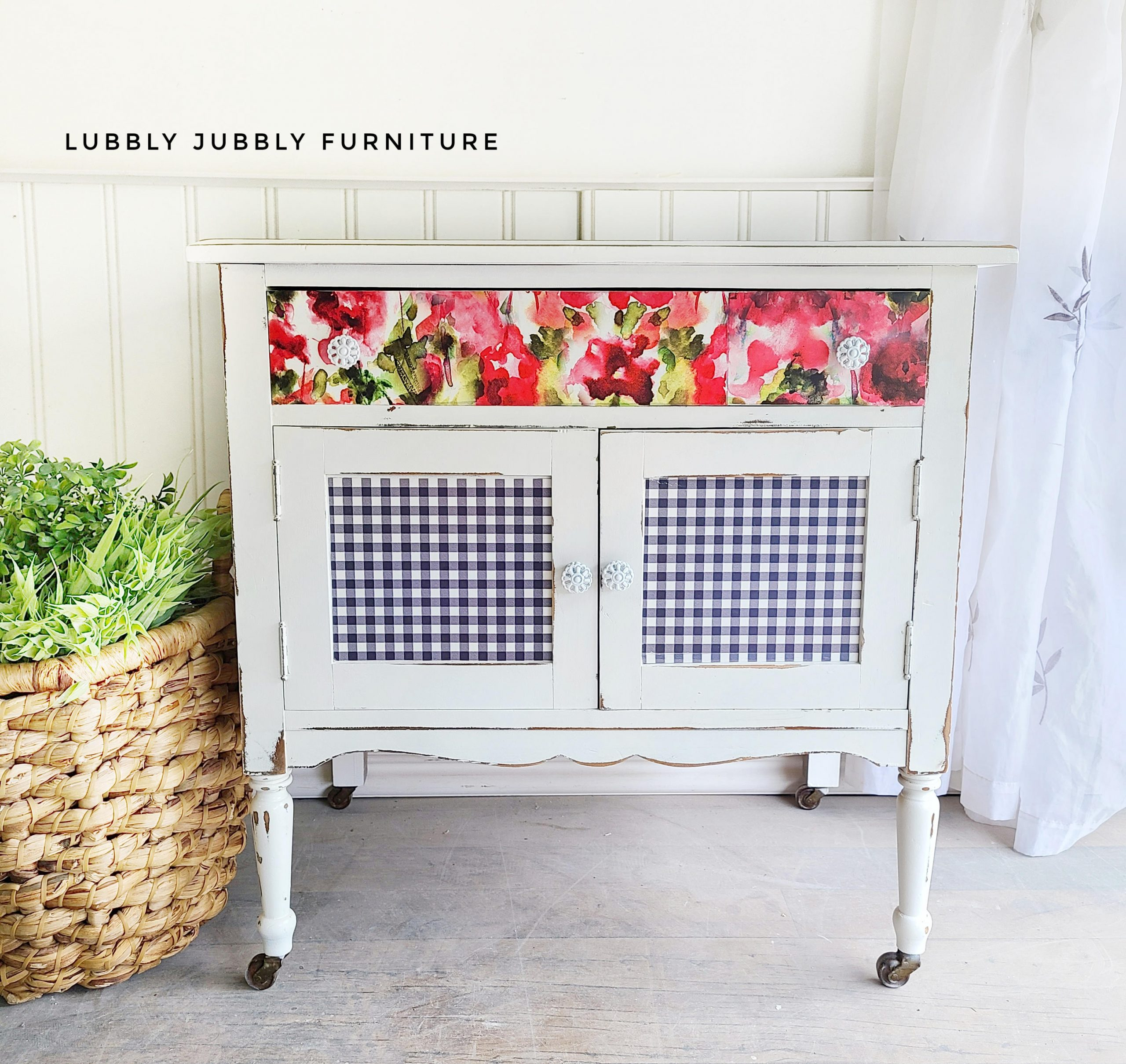 farmhouse cabinet with gingham and floral decorative front crinoline white casters wicker basket with plant