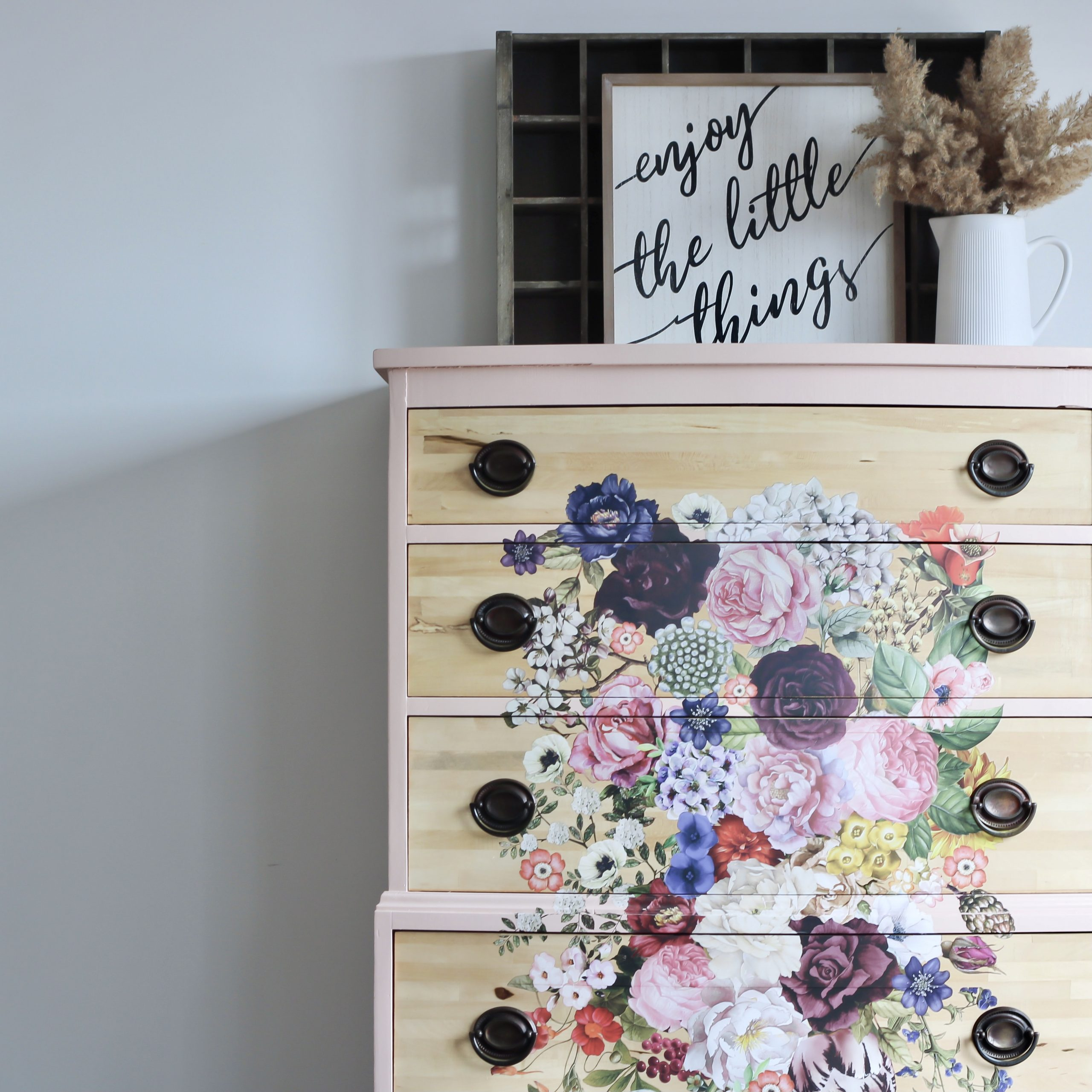tall dresser in pale pink with floral transfer and pewter hardware