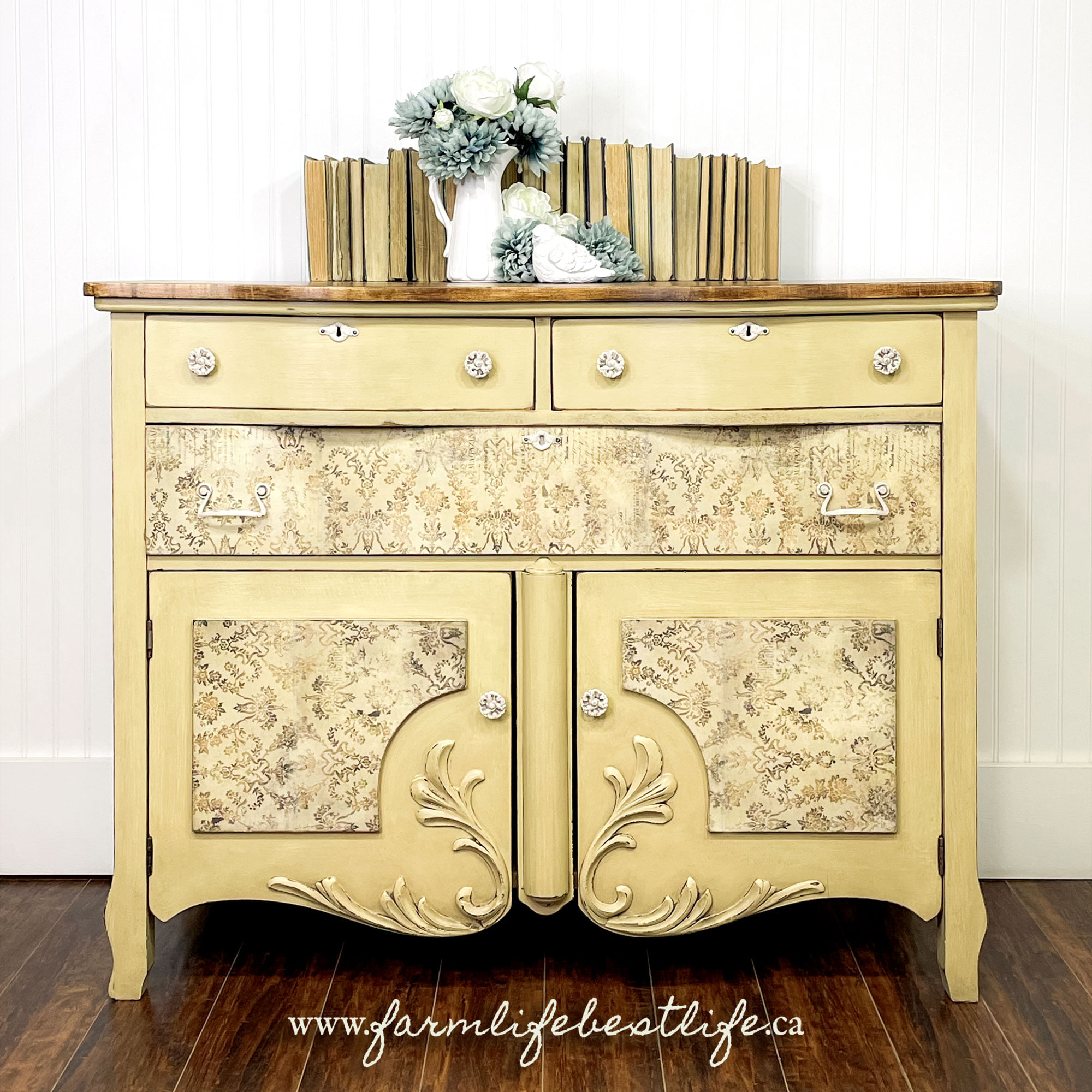 pale yellow dresser/cabinet with natural wood top and rice paper drawer fronts