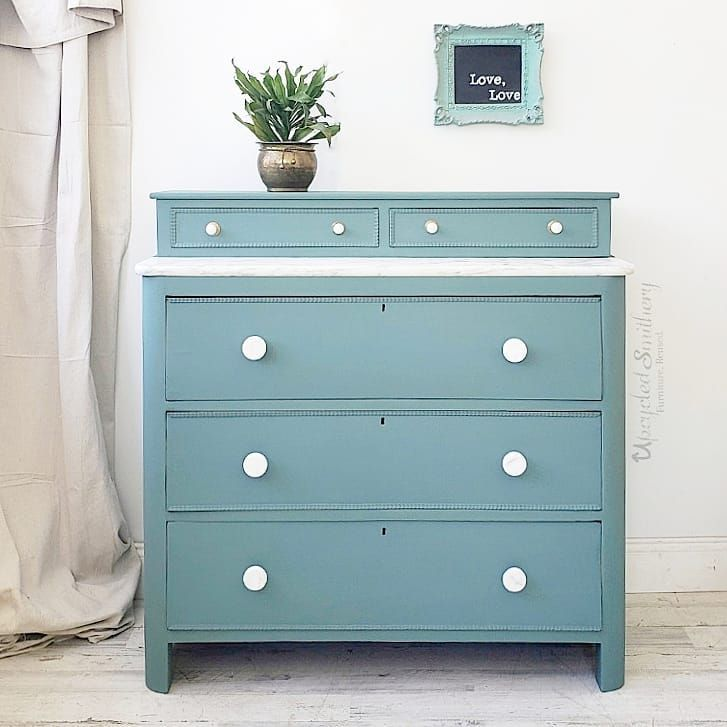 dresser in wanderess with marble top and porcelain knobs potted plant framed chalkboard