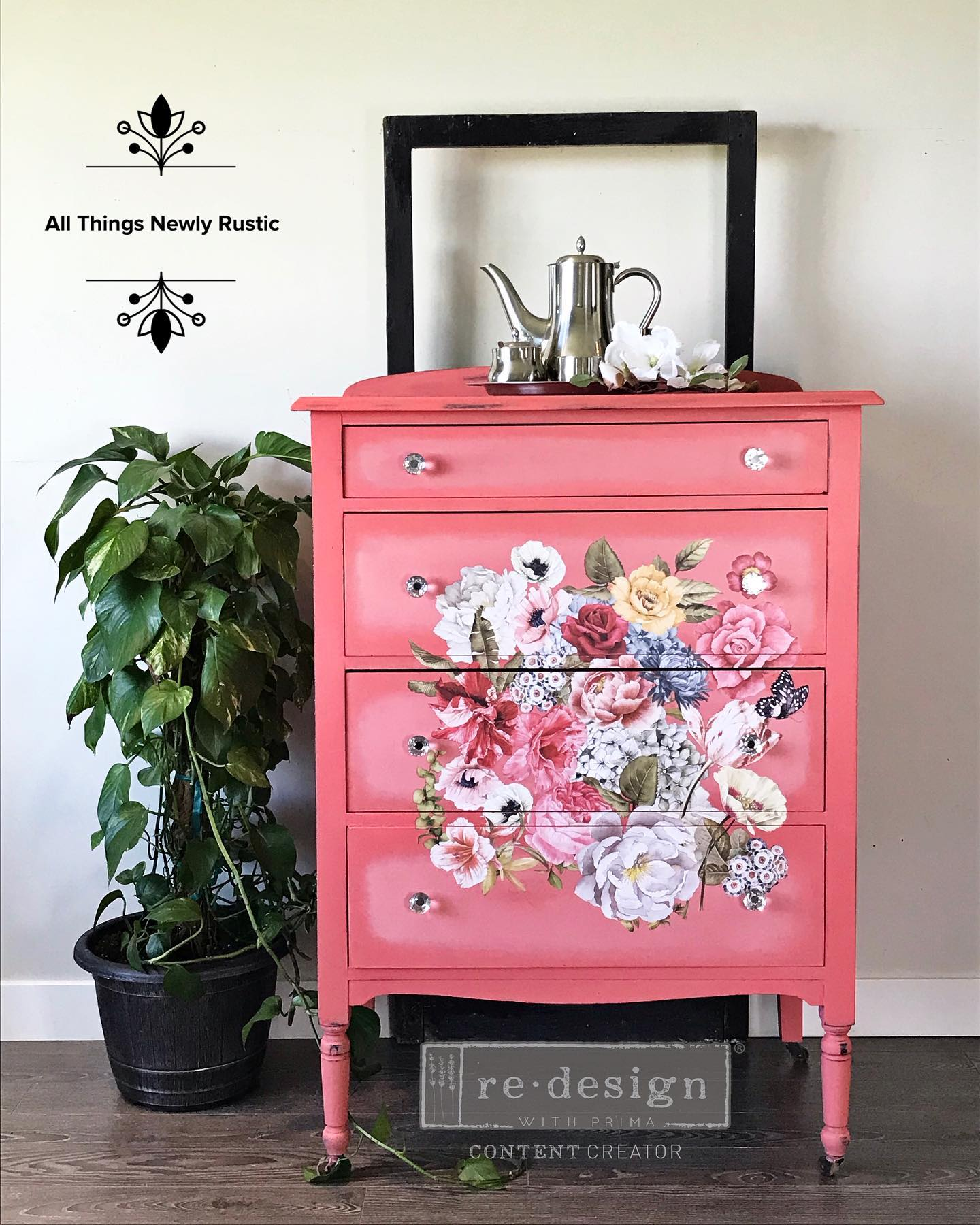 tall dresser in bright coral with floral transfer potted plant